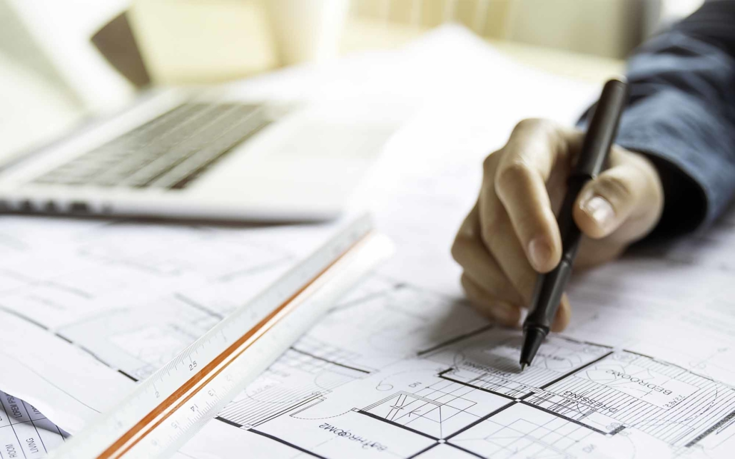 Hexa engineer worker looking at layouts and designs